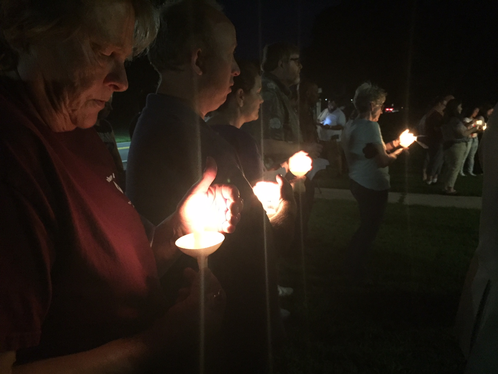 Members of the Perryman community participate in a candle-light prayer vigil at Cranberry UMC Sept. 21 following the mass shooting at the Rite Aid Distributoin Center one mile away. Photo by Erik Alsgaard.